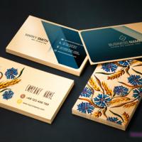 Eleganckie wizytówki wydrukowane na złotym papierze ozdobnym.