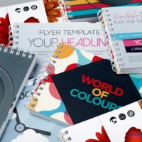 Kolorowe broszury w oprawie spiralowanej wydrukowane na papierach kredowych.